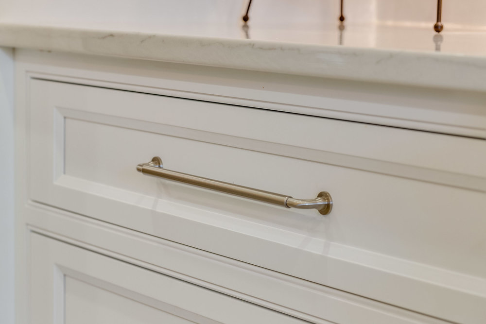 Satin nickel cabinet drawer pulls by Top Knobs.