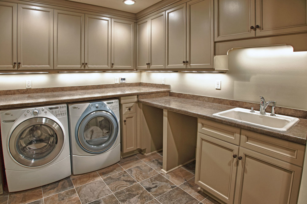 Laundry room design with LED lighting, cabinetry and undercounter LED lighting.