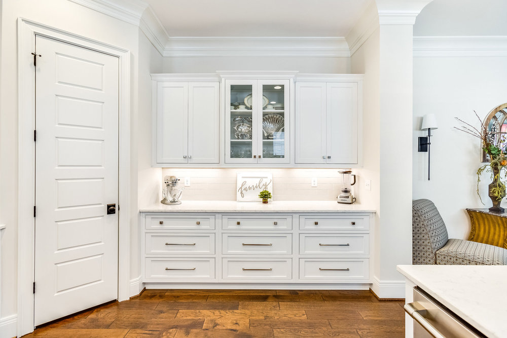 Shiloh beaded inset cabinetry in Artic White