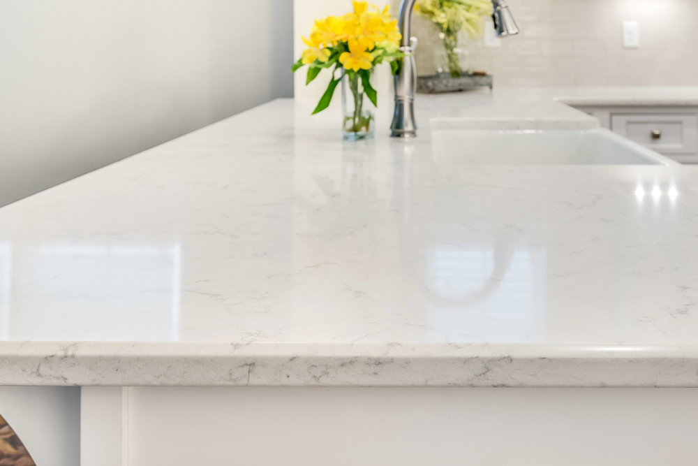 LG Viater quartz countertops in the Minuet pattern with a quarter bevel edge profile.