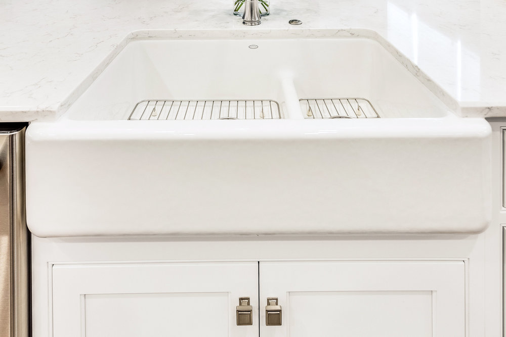 Kohler Whitehaven sink and Top Knobs satin nickel hardware.