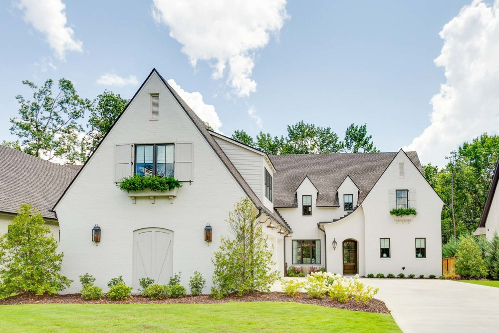 "The design of this home is best described as ""Tudor meets French Country""."