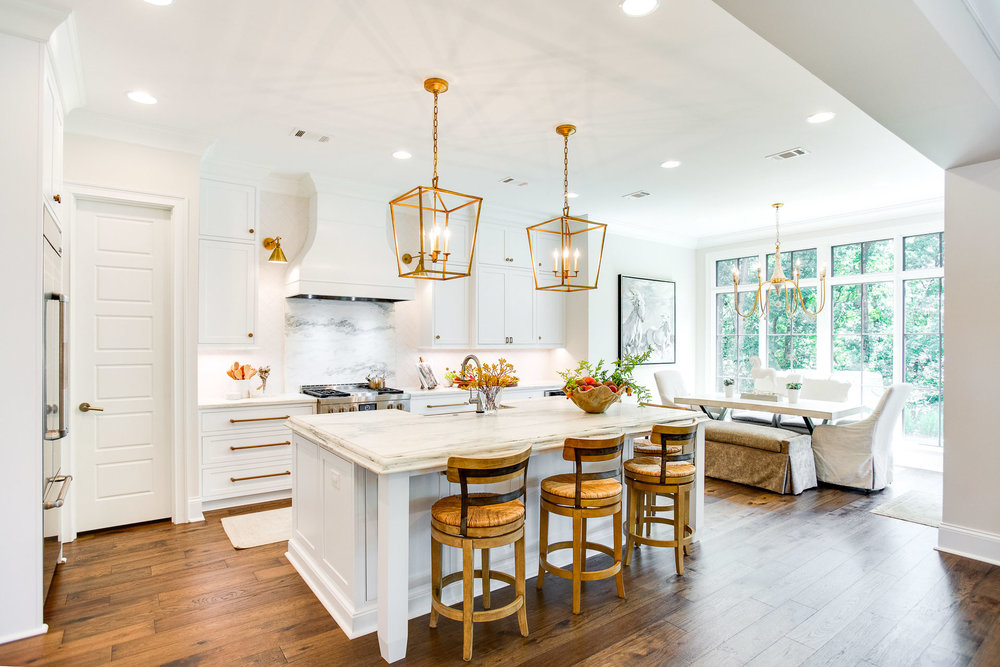 The kitchen is designed with semi-open concept breakfast nook and a doorway that leads to the back porch