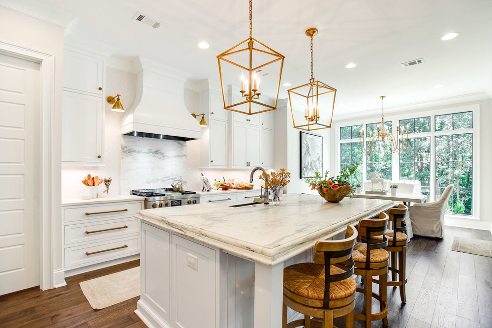 The kitchen in this newly constructed home has Montclair Danby marble countertops and range backsplash.