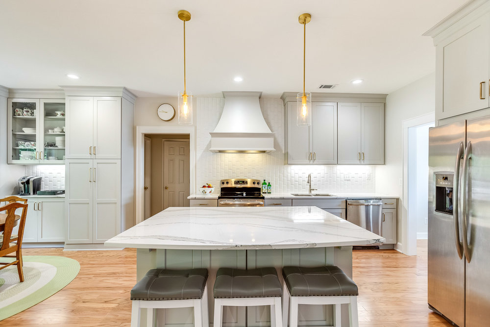 An open concept kitchen with a large Cambria Britannica quartz kitchen island countertop.