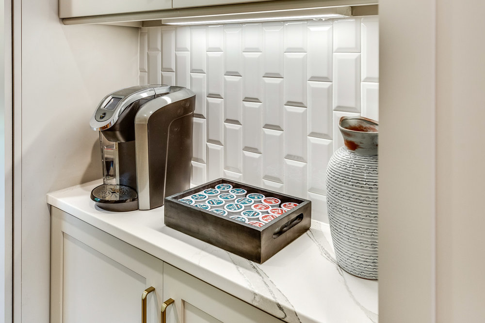MSI beveled white subway tile backsplash placed vertically.