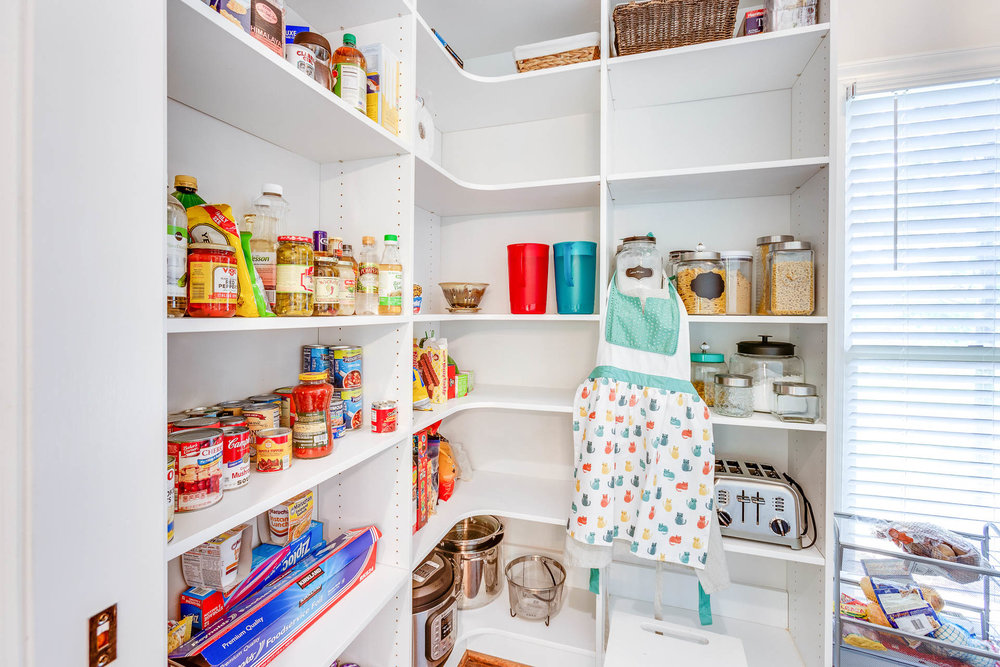 Adjustable shelving is used in the custom kitchen pantry and laundry room.