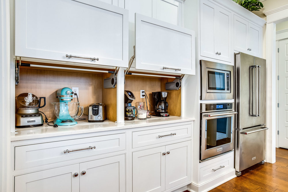 Shiloh Cabinetry appliance storage with cabinets open.