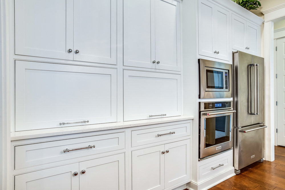 Shiloh Cabinetry appliance storage with cabinets closed.