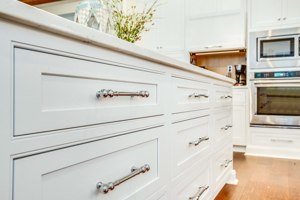 The cabinet hardware is by Top Knobs.