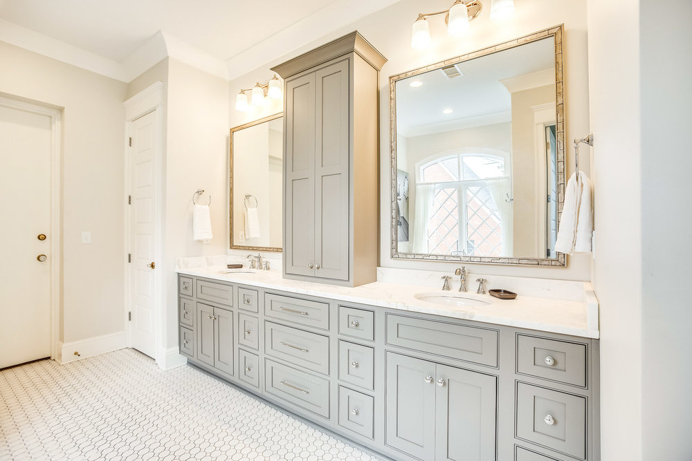 A FEMA approved storm shelter is located through the door in this bath.
