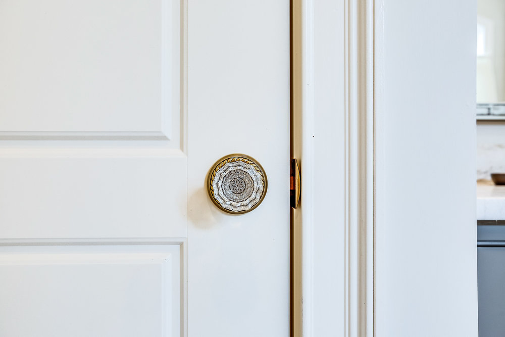 Emtek crystal door knobs with a French antique finish backplate.