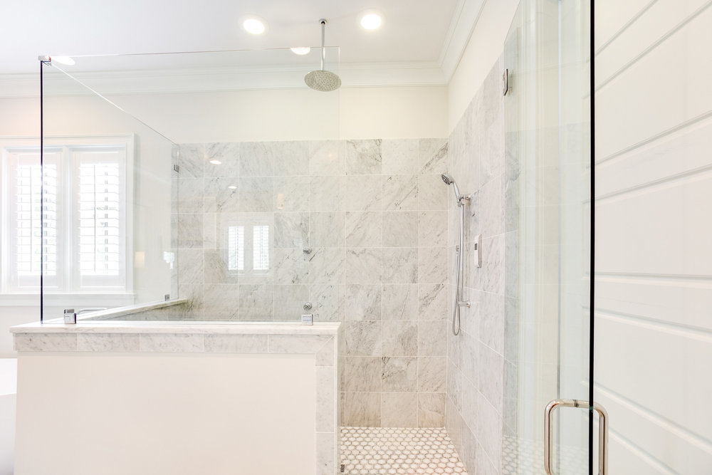 Carrara marble tile was used throughout the shower.