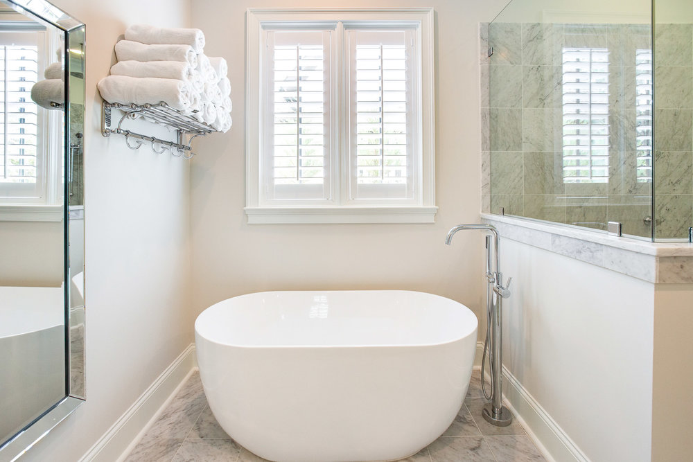 The soaking tub is by Oceana and the tub filler is Fergusson Mirabelle.