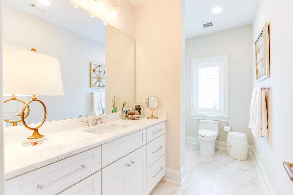 One of the four bathrooms in this home.