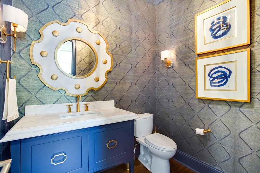 First floor powder room with wallpaper.