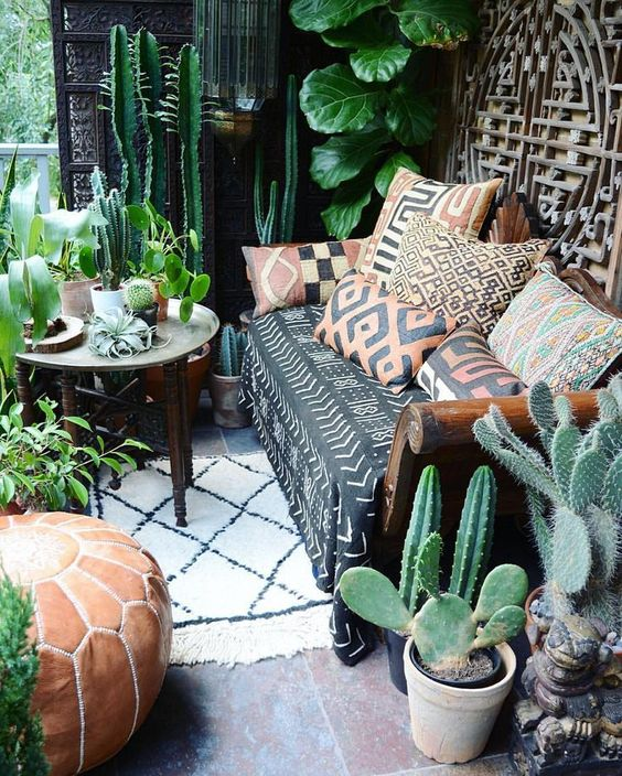 This hipster looking living space is filled with cactus and bold fabric prints so what's not to love?