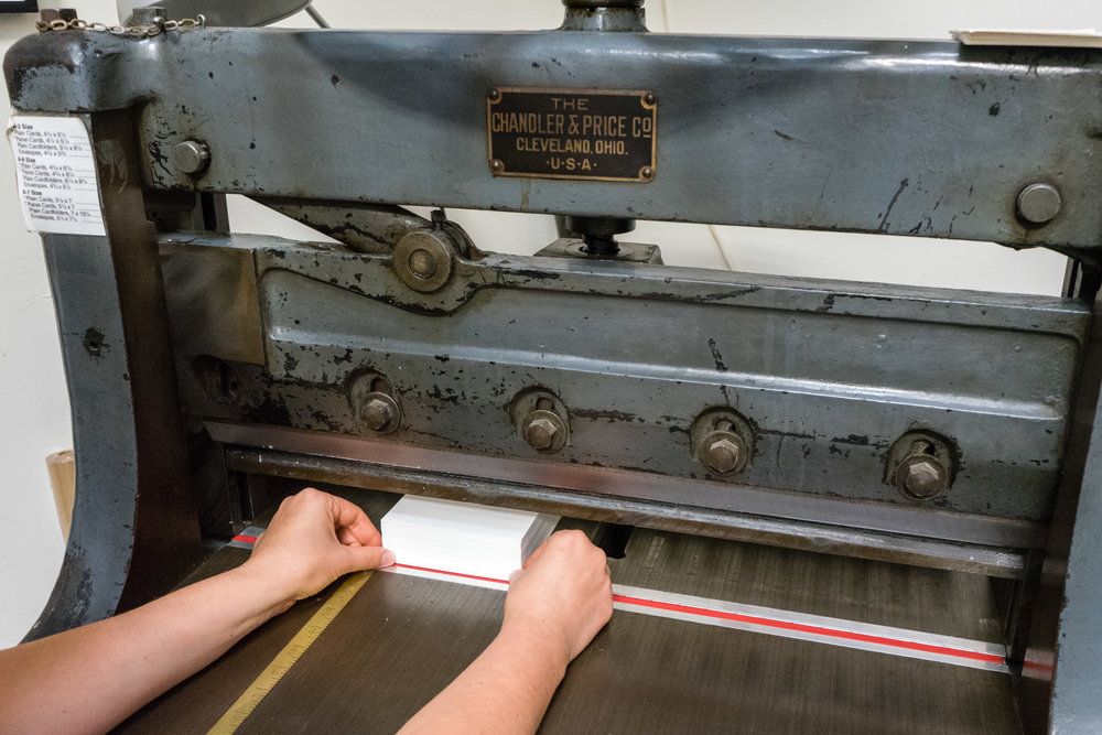 Cutting cotton paper down to size for invitation printing