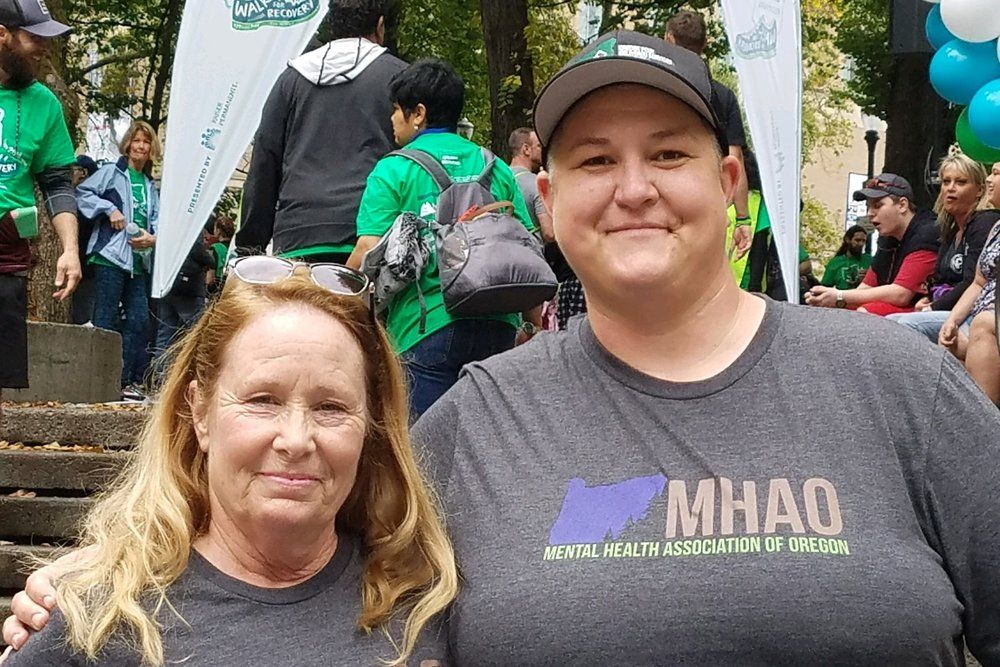 Marianne O'Neill-Tutor (Peer Support Specialist Recovery Mentor, pictured right) and Cee Carver (EVOLVE West Department Director, pictured left) proudly representing the MHAO team.  Photo credit: Janie Gullickson