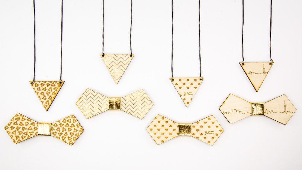 Live fashion experiential activation. Live laser engraved bow ties and pendants