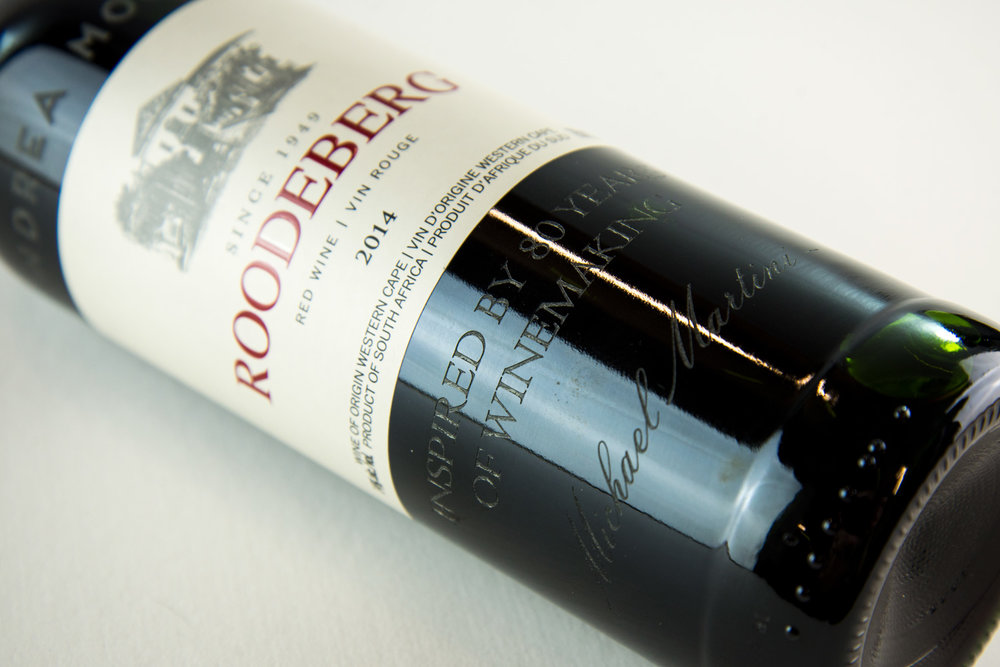Engraving on wine bottles at an event