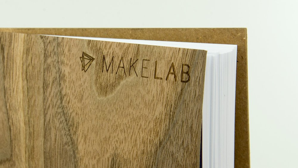 Custom monogrammed notebooks, artist on site
