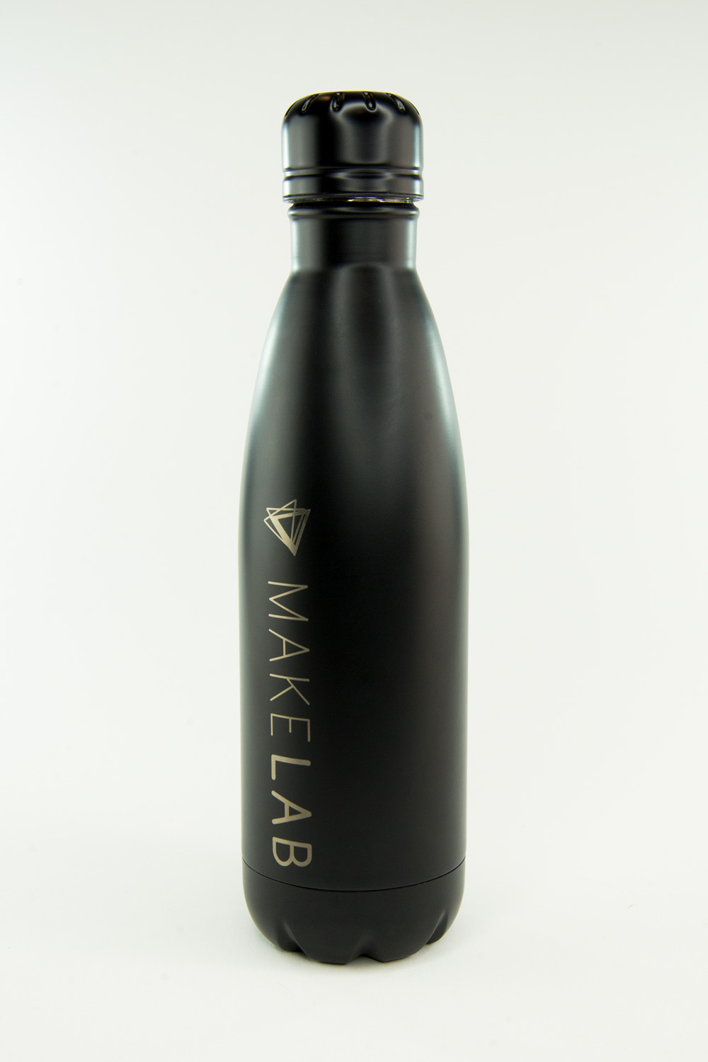Custom water bottles made in tradeshow booth