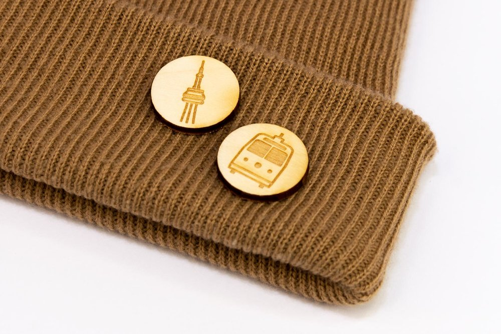Laser engraved lapel pins on a hat