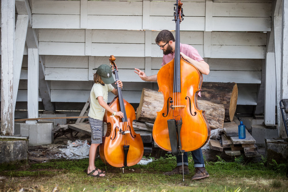 A new bass student gets his first lesson at the music festival!