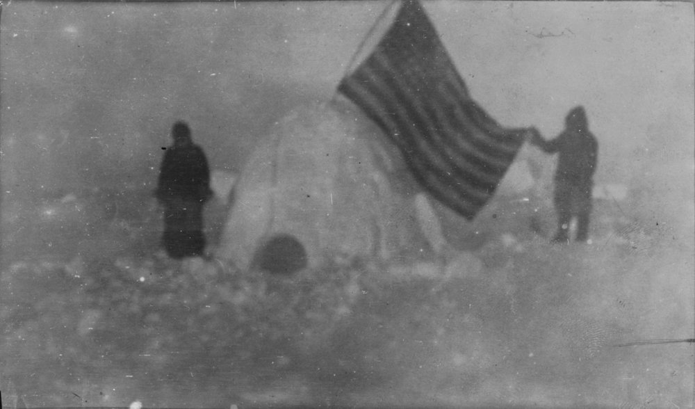 After Cook 1908  [Two members of Frederick Cook's expedition, with U.S. flag stuck in igloo, at expedition site, North Pole] ([1908], c1909)  After a digital image by Library of Congress, Prints and Photographs Division (Washington March 28th 2001),  after a 1909 gelatine silver print (1909) in the collection of Library of Congress