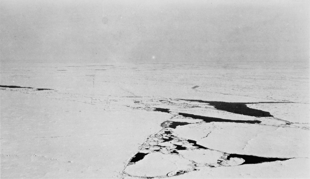 "After Amudsen 1926  [View from ""Norway"" down on the ice over the North Pole (the geographical North Pole). The three flags have been dropped from the airship and can be seen down at the ice] (May 12th 1926) (c1926)  After a digital image by The National Library of Norway,  after a silver gelatine fibre based original print in the collection of The National Library of Norway"