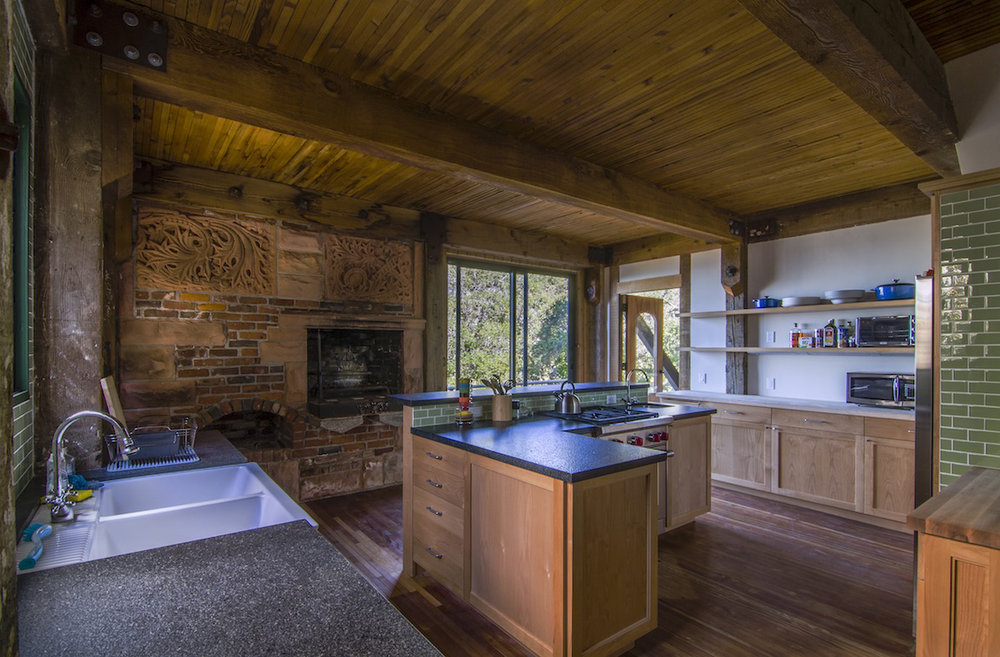 Kitchen with the wood burning fireplace.