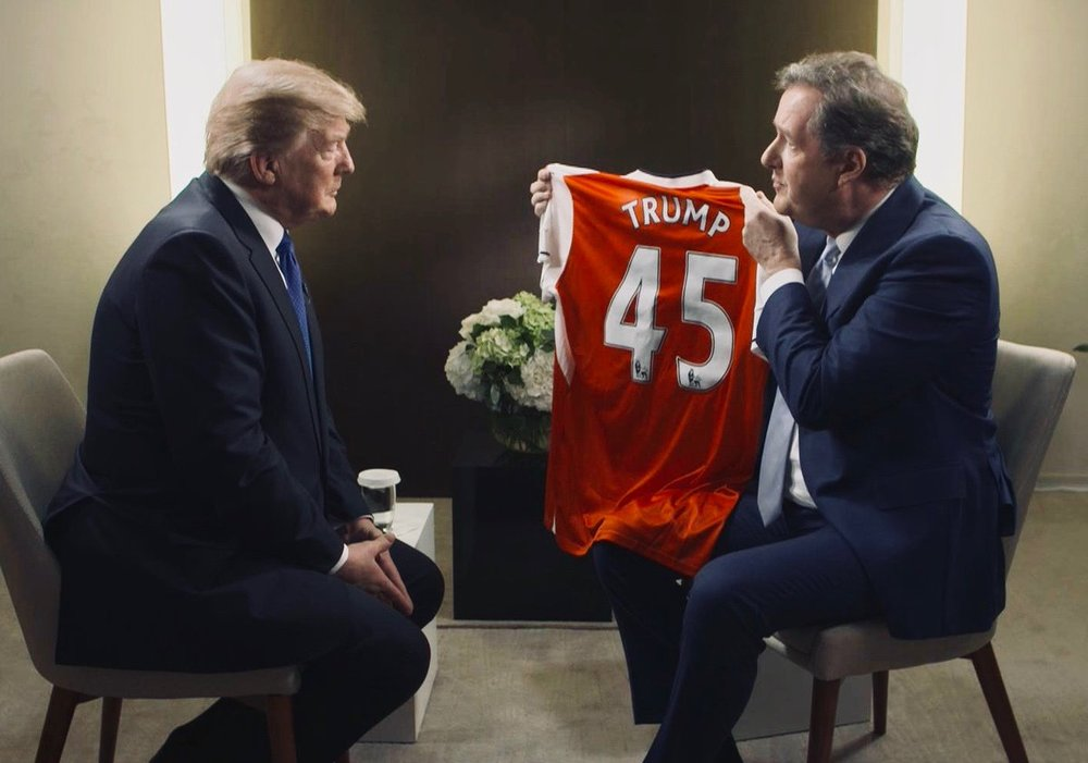 Two big soccer fans having a regular conversation.