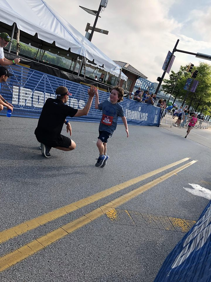Coach_Terry_Wilson_Andrew_Starykowicz_Ironman_Chattanooga_70.3_High_Fives2.jpg
