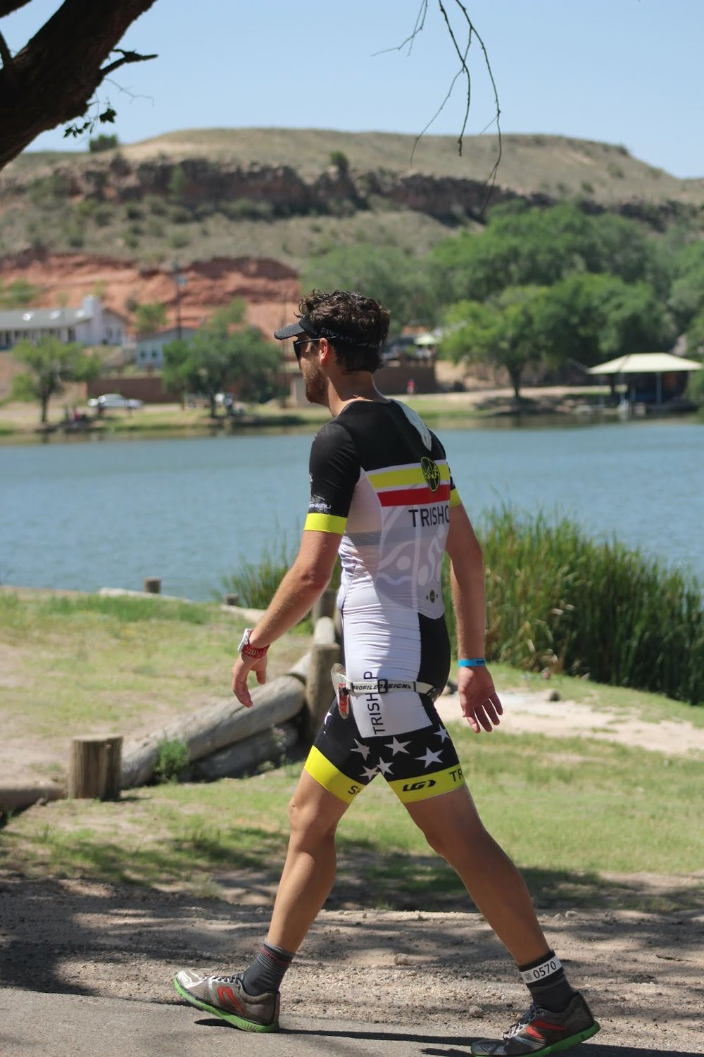 Coach_Terry_Wilson_Pursuit_of_The_Perfect_Race_IRONMAN_Buffalo_Springs_Lake_70.3_Avram_Carter_Walk.JPG
