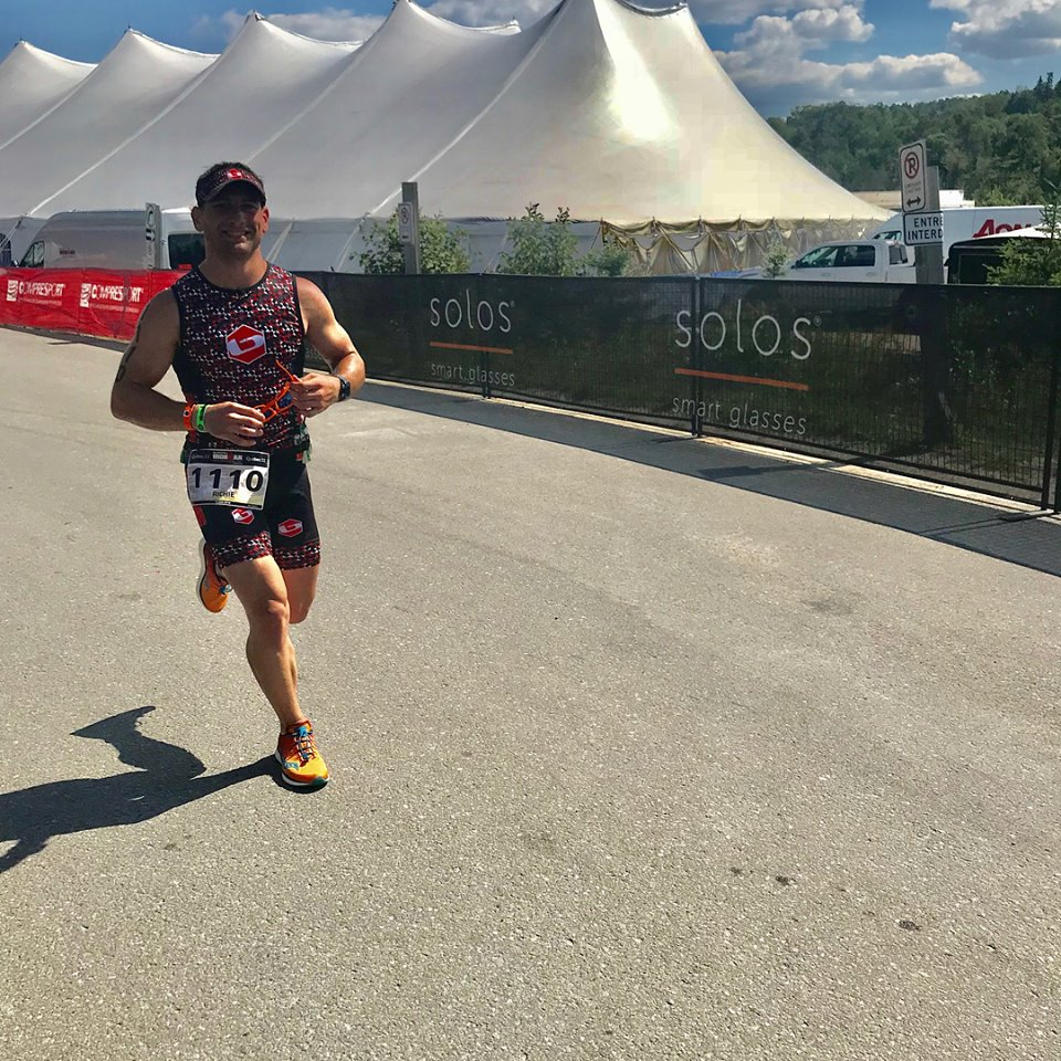 Coach_Terry_Wilson_Pursuit_of_The_Perfect_Race_IRONMAN_Mont_Tremblant_Richie_Szeliga_Smiling_Run.jpg