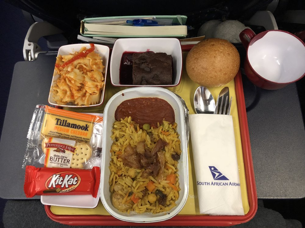 Coach_Terry_Wilson_Pursuit_of_The_Perfect_Race_IRONMAN_Food_on_Plane.jpg