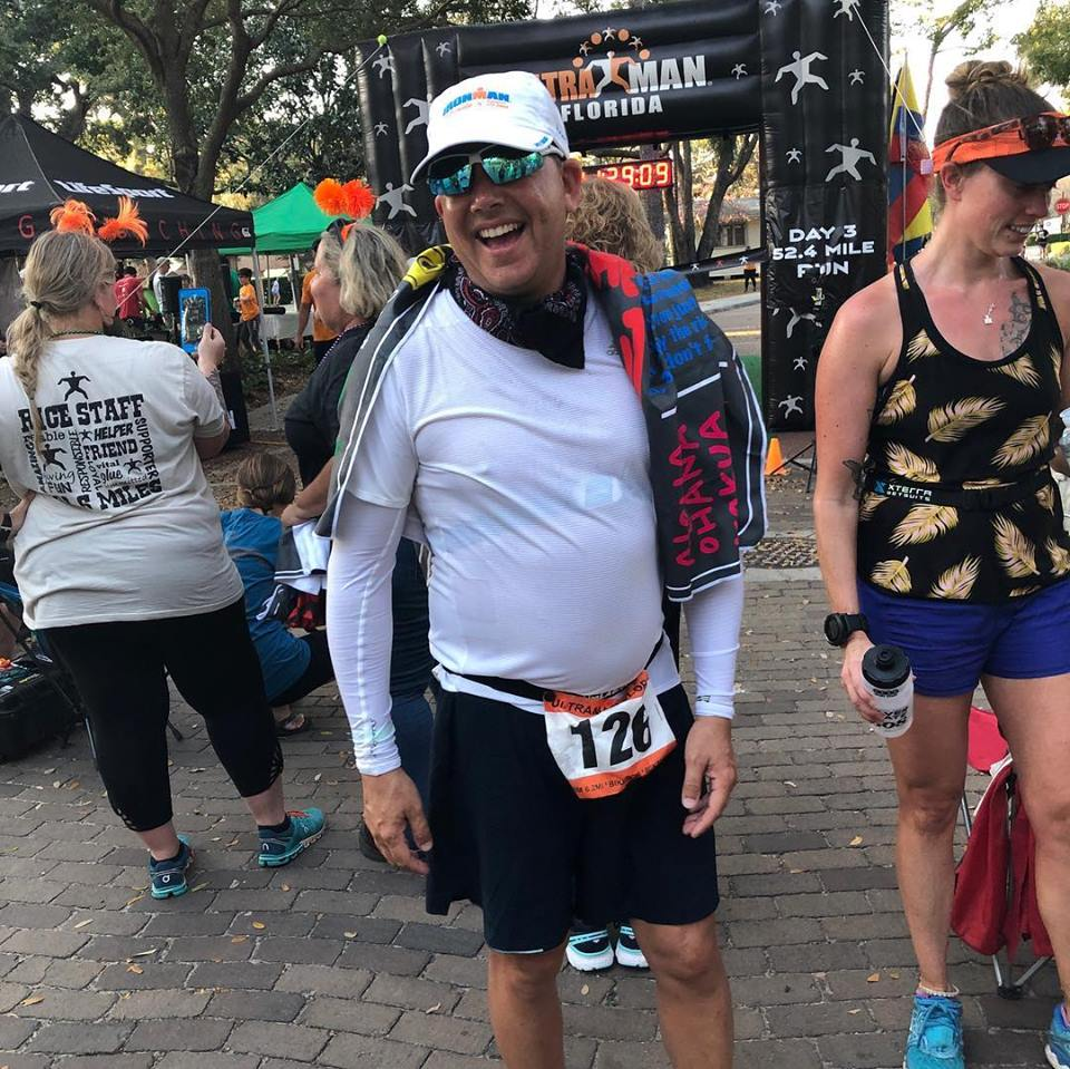 Coach_Terry_Wilson_Pursuit_of_The_Perfect_Race_Ultraman_Florida_Julian_Summers_finish_line_Smile.jpg