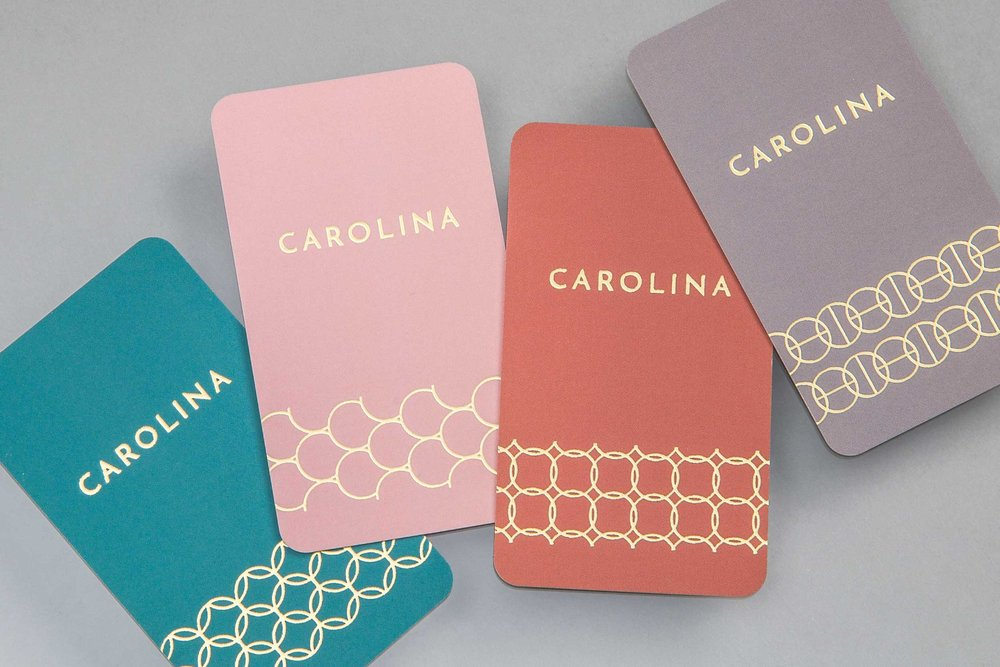 Business cards with unique pattern designs in gold designed for the creative brand Carolina Boutique.
