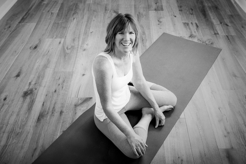 Black and white portrait of Pam Howard, Pilates instructor and founder of Core and More.