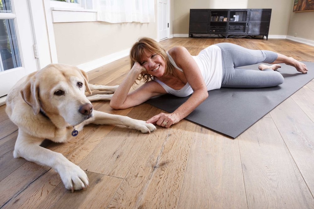 Pam Howard, Pilates instruct with dog Reggie.