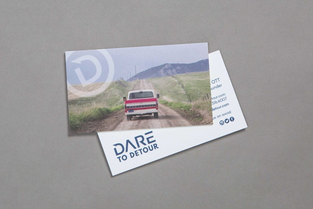 Business cards that represent Dare to Detour identity.