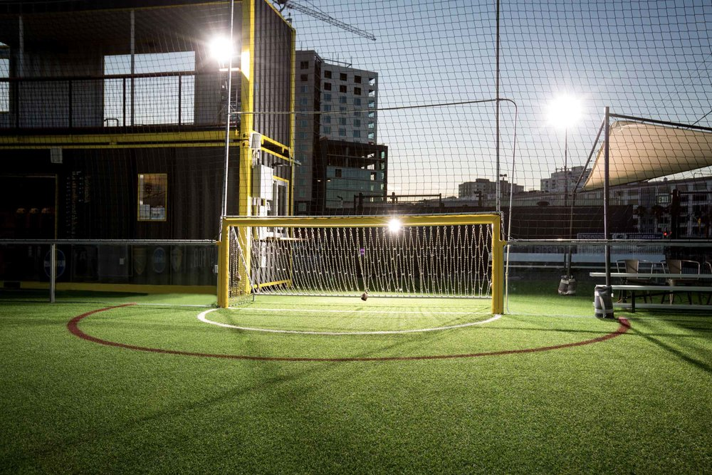 Dusk shot of yellow goal at Urban Soccer Park in San Francisco.