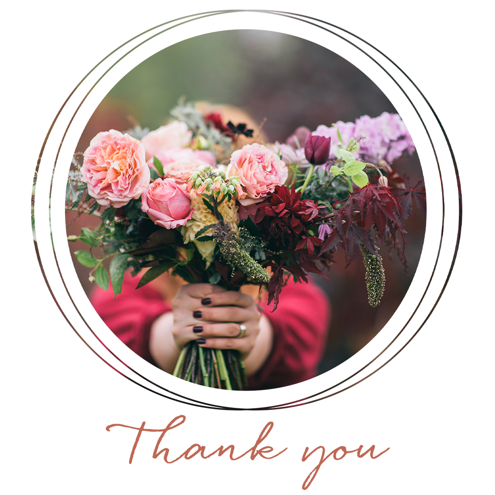 A female holding a bouquet of flowers for a Thanksgiving social media post for Carolina Boutique clothing brand.