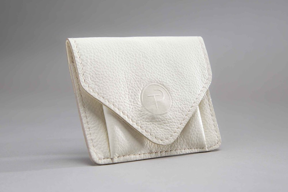A leather pouch that holds the Thomas Pinck jewelry.