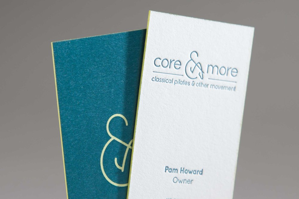 Letterpress business cards showing the Core and More identity.