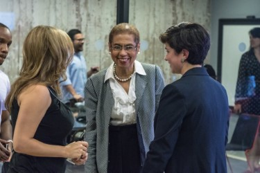 Congresswoman Eleanor Holmes Norton (center) speaks with Laila Makled (right) and a Women Grow attendee