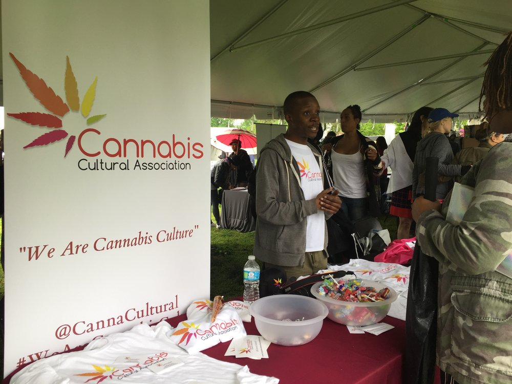 Jake Plowden of the Cannabis Cultural Association speakers with an attendee at the 2018 National Cannabis Festival.