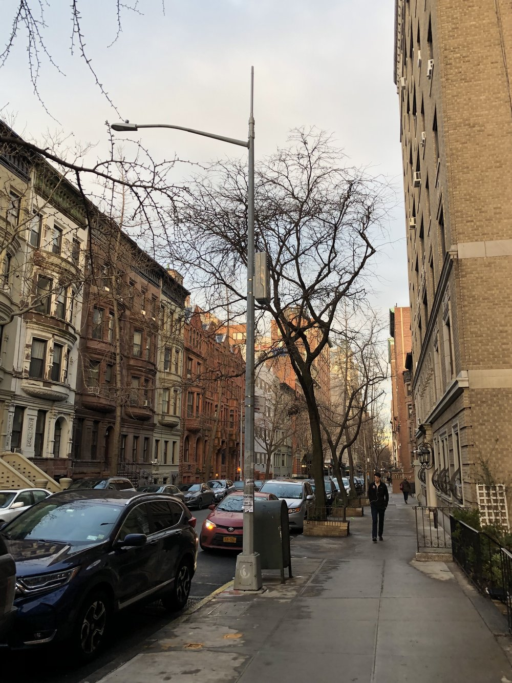 Here is the same light pole. Notice how close this antenna is to the 6th and 7th floor windows of this high-end building. Photo © 2019