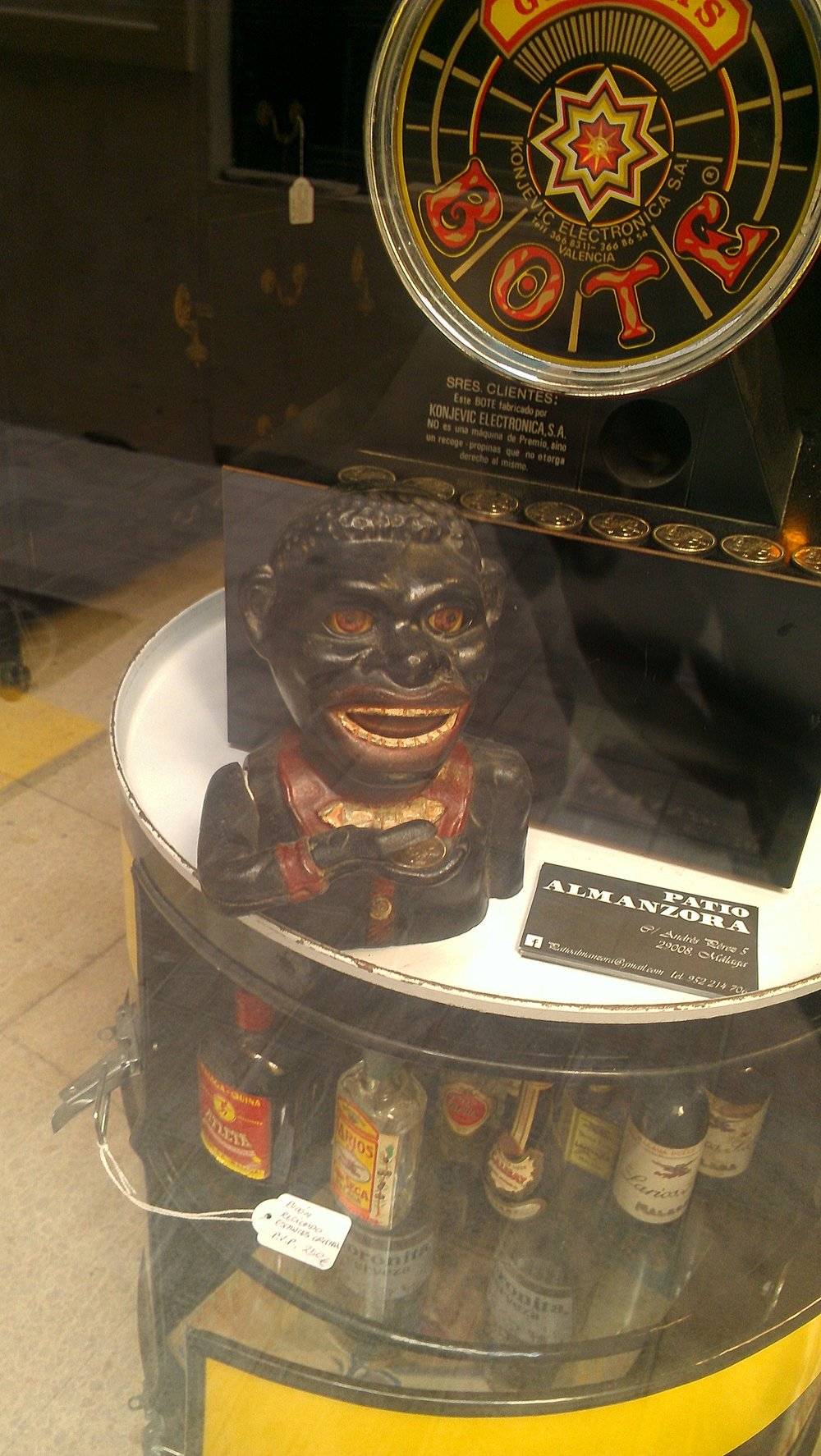 'black sambo' figurine on display in a vintage curiosity shop - Malaga